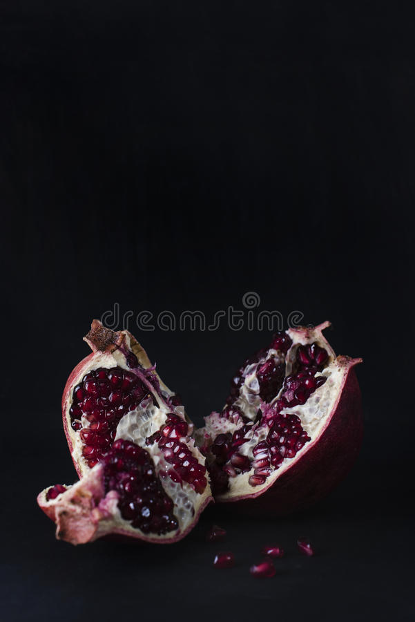 Pomegranate fruit with seeds inside. royalty free stock photo