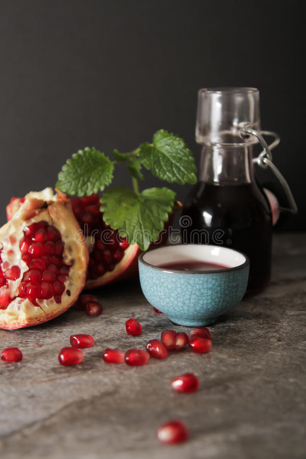 pomegranate juice in a blue circle and juicy royalty free stock images