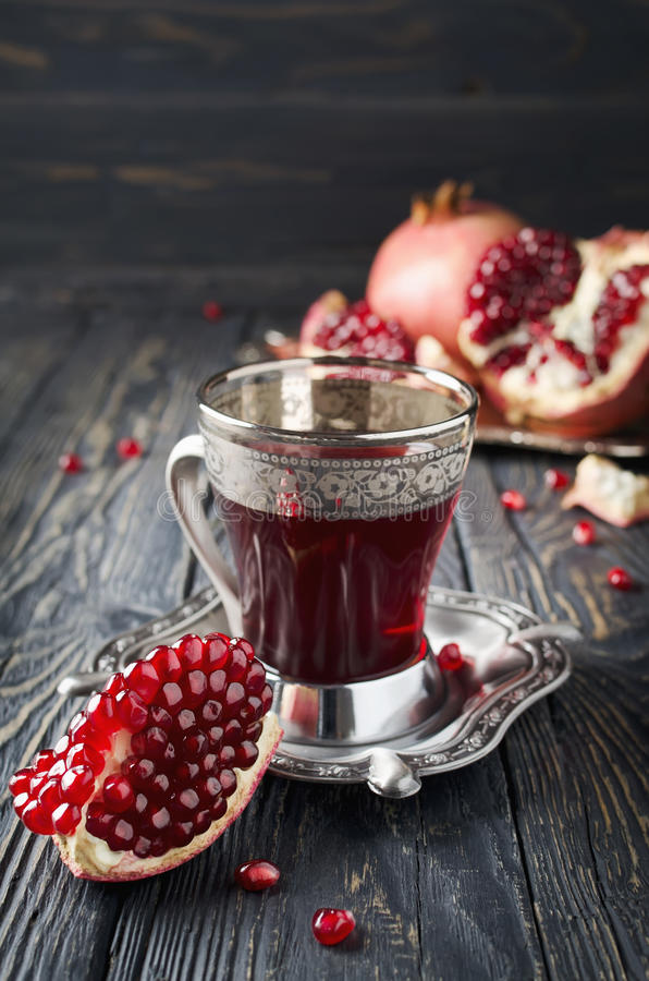 Pomegranate juice and pomegranate royalty free stock images