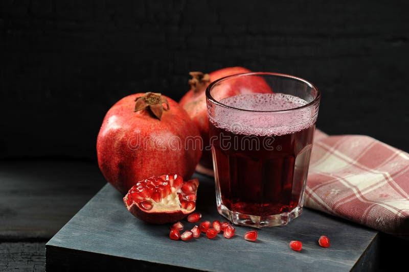 Pomegranate juice pomegranate whole stock image