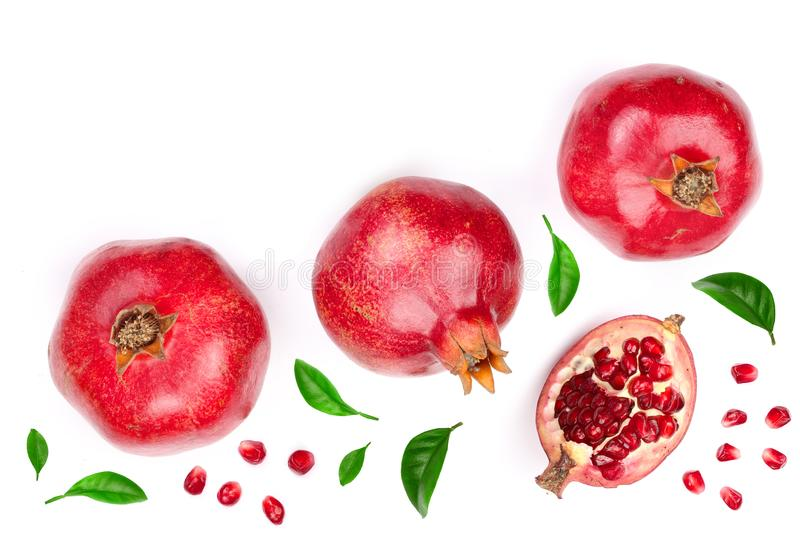 Pomegranate with leaves isolated on white background with copy space for your text. Top view. Flat lay pattern royalty free stock images