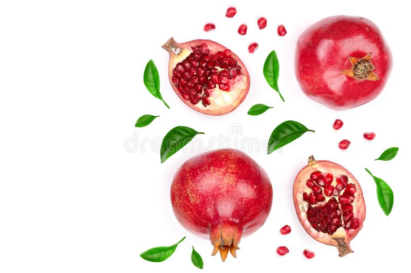 Pomegranate with leaves isolated on white background with copy space for your text. Top view. Flat lay pattern royalty free stock photo