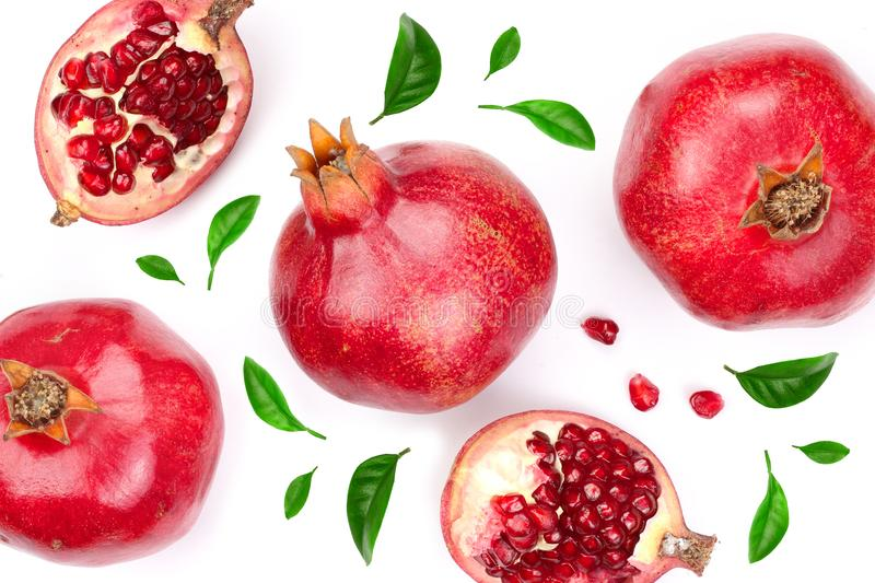 Pomegranate with leaves isolated on white background. Top view. Flat lay pattern royalty free stock images