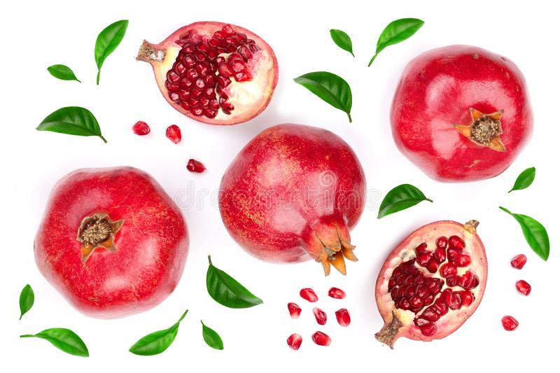 Pomegranate with leaves isolated on white background. Top view. Flat lay pattern stock image