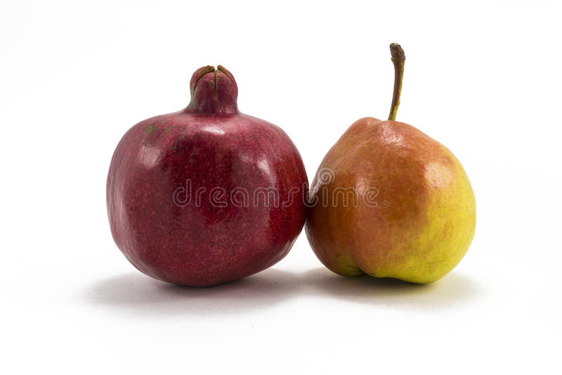 Pomegranate and pear on a white background royalty free stock photo