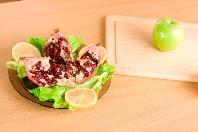 Download Pomegranate on a plate stock photo. Image of fleshy, lemon - 12923650