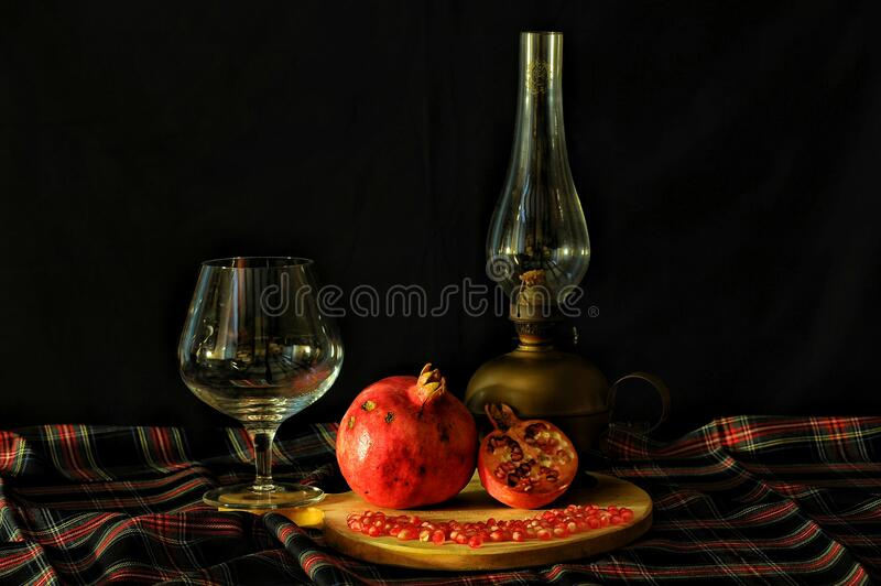 Pomegranate with retro tableware stock images