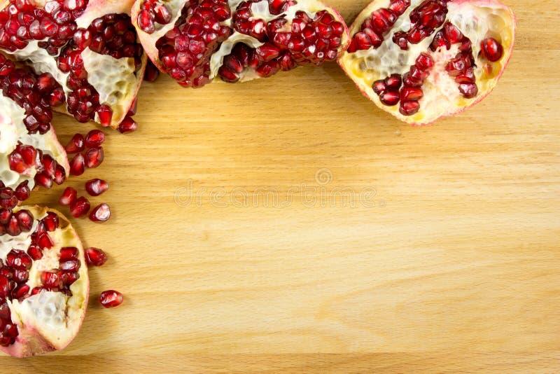 Pomegranate seed frame background royalty free stock photo