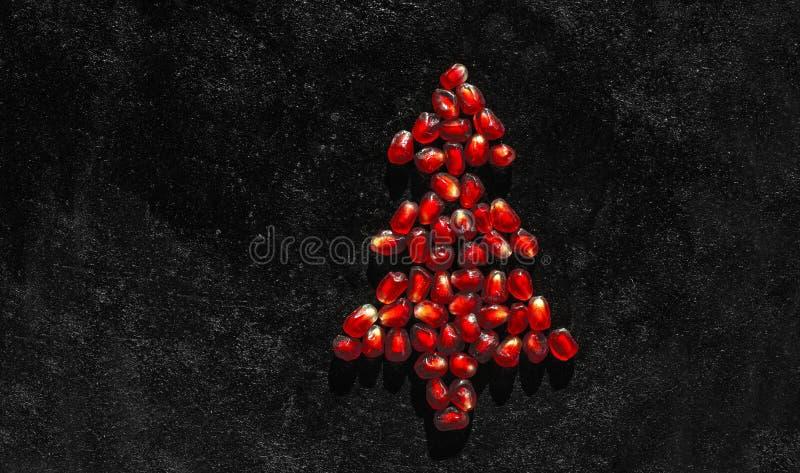 Pomegranate seeds like a Christmas tree - postcard royalty free stock photos