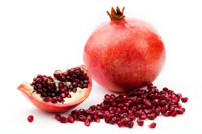 Pomegranate on a white stock photography