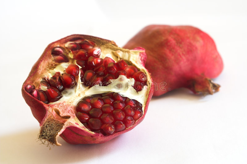 Pomegranate on a white background stock photo