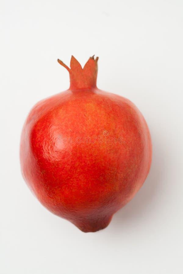 Pomegranate on white background stock images