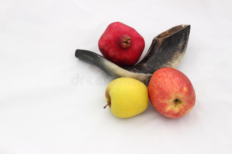 Pomegranates, apples and a horn symbols of the Jewish new year (. Pomegranates are traditional symbol of Jewish new year symbolizing many good deeds as the seeds stock photography