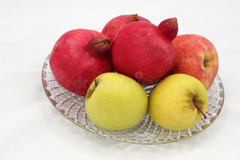Pomegranates and apples symbols of the Jewish new year (Rosh HaS. Pomegranates are traditional symbol of Jewish new year symbolizing many good deeds as the seeds royalty free stock photography