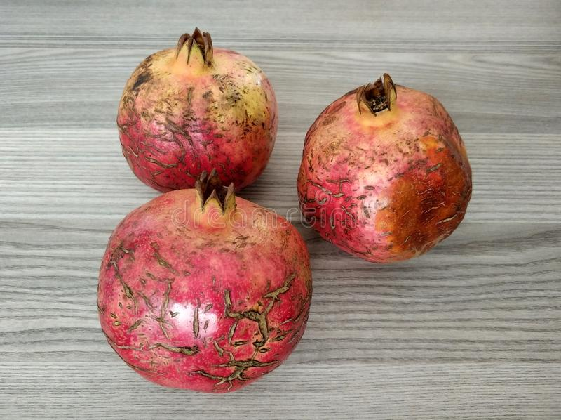 Pomegranates on a wood table royalty free stock images