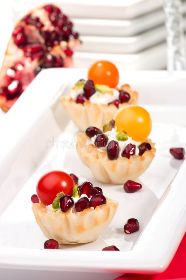 Pomegranates and cream cheese canapes stock image image for Canape shells