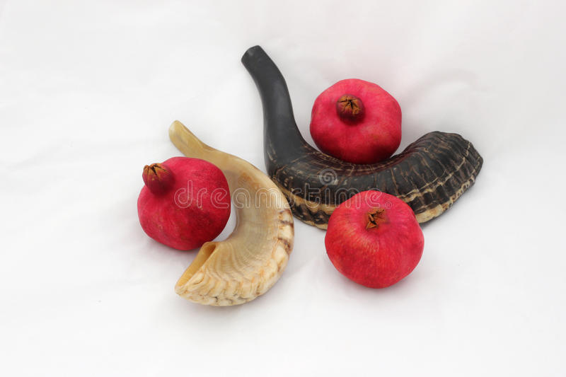 Pomegranates and a horn symbols of the Jewish new year (Rosh HaS. Pomegranates are traditional symbol of Jewish new year symbolizing many good deeds as the seeds stock photography