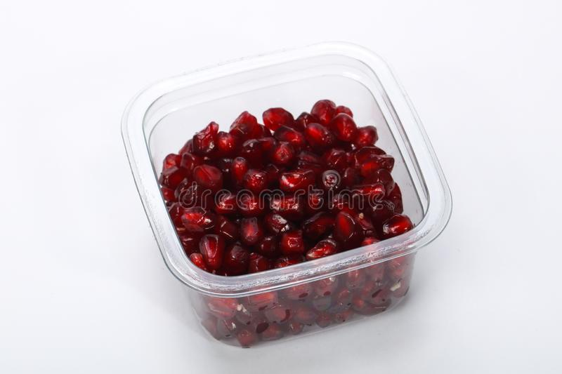 Pomegranet-Samen im Plastikkasten lizenzfreie stockbilder