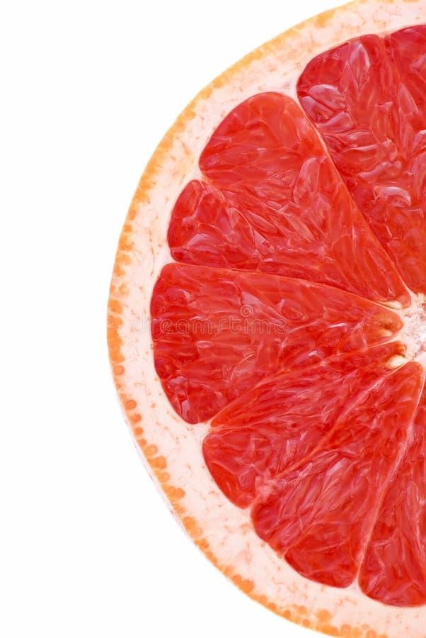 Pomelo. Fresh half sliced pomelo as closeup on white background royalty free stock image