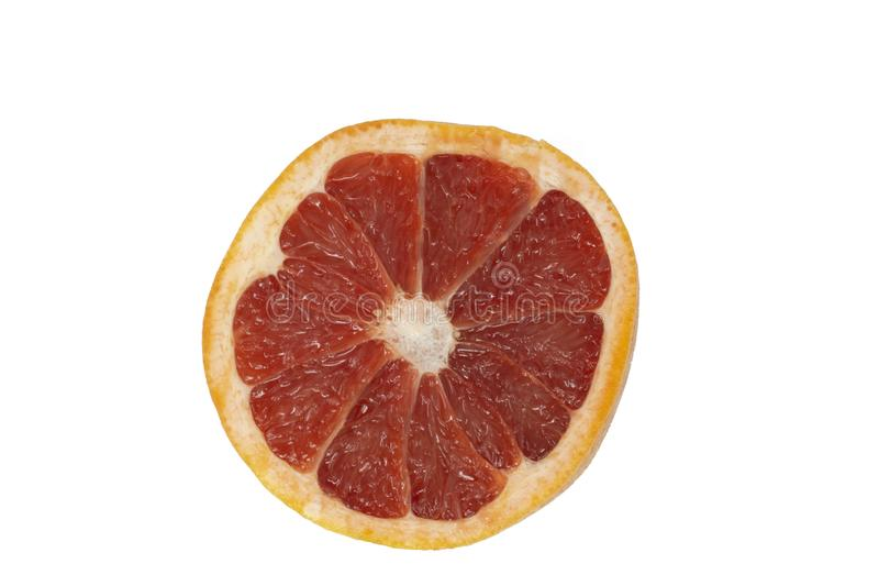A pomelo or grapefruit cut in half isolated stock photo