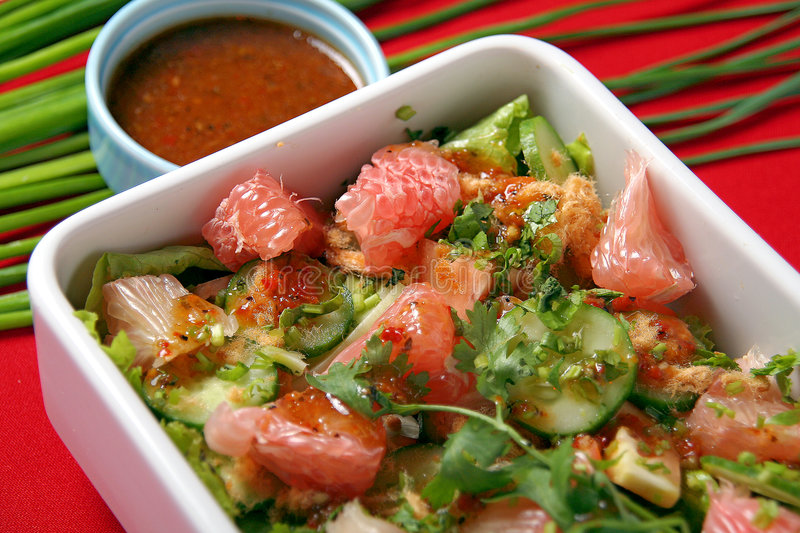 Pomelo vegetable salad. On red background royalty free stock images