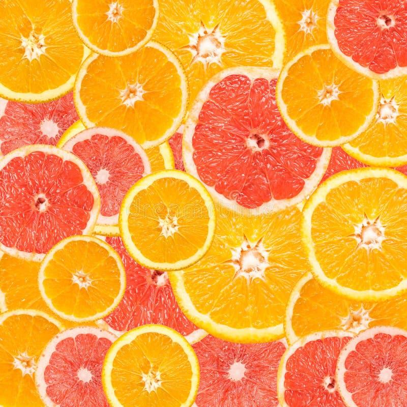 Pomelo y extracto anaranjado de la rebanada foto de archivo