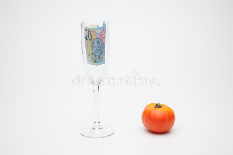 Pomidor i pieniądze, mnóstwo pieniędzy obraz royalty free
