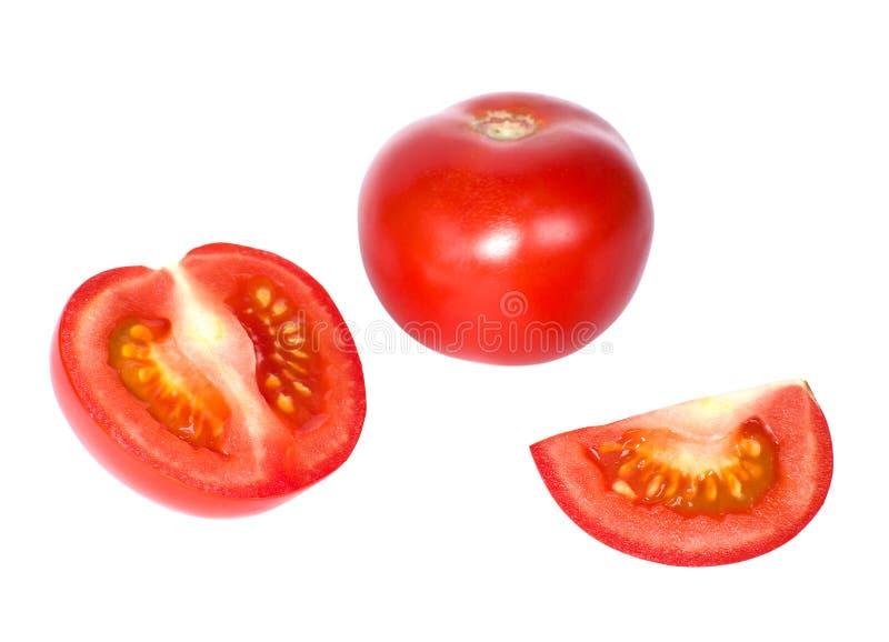 Pomidor i plasterki pomidorowy zbliżenie fotografia royalty free