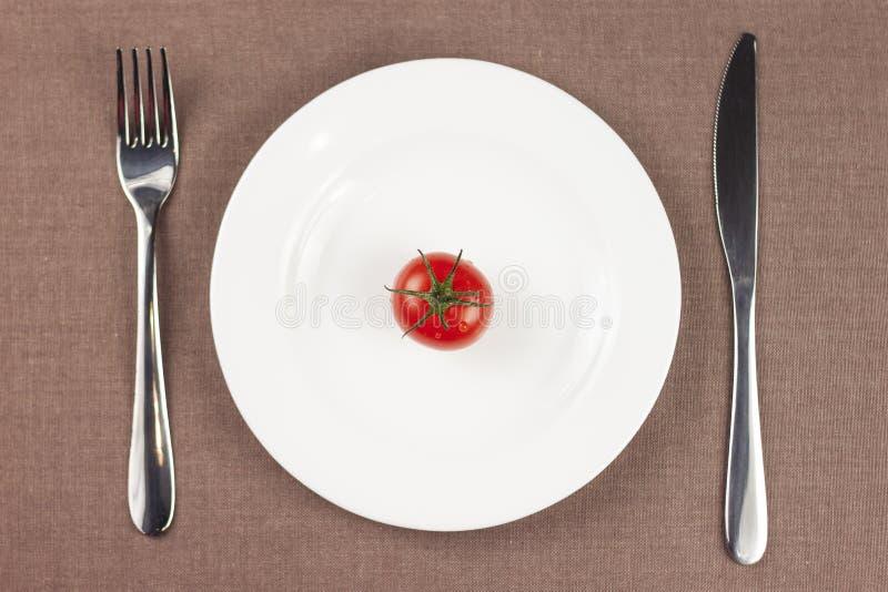Pomidor na talerzu zdjęcia royalty free