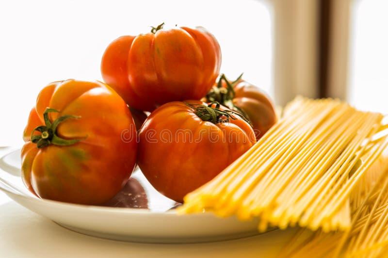 Pomidory, makaron, talerz, kumberland, spaghetti zdjęcie stock