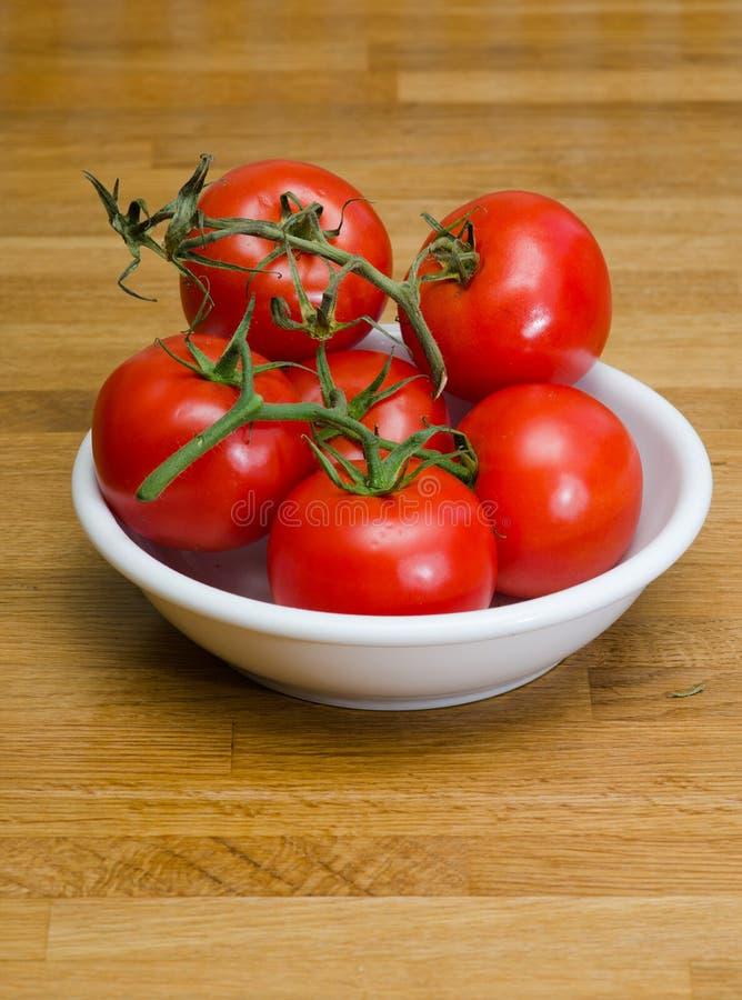 Pomidory w pucharze obrazy royalty free