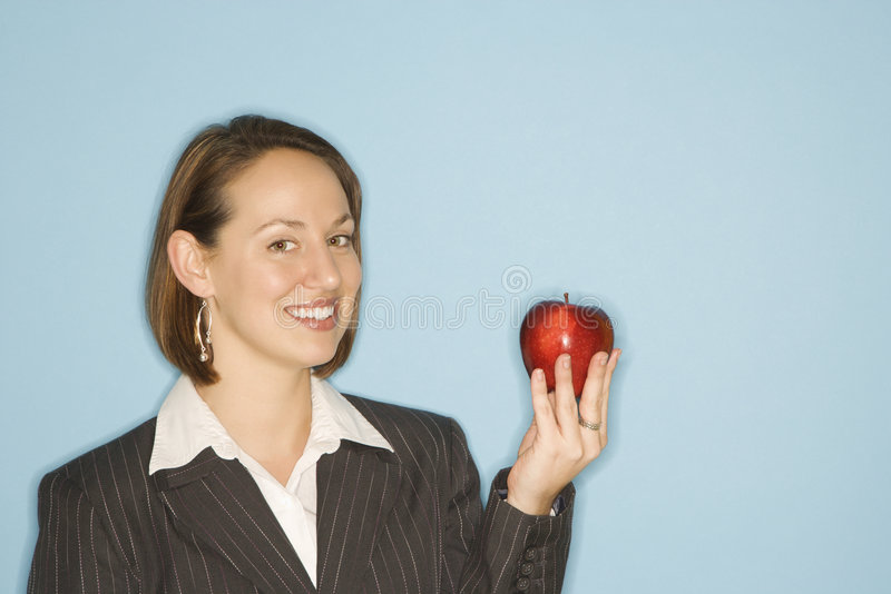 Pomme de fixation de femme d'affaires. image libre de droits