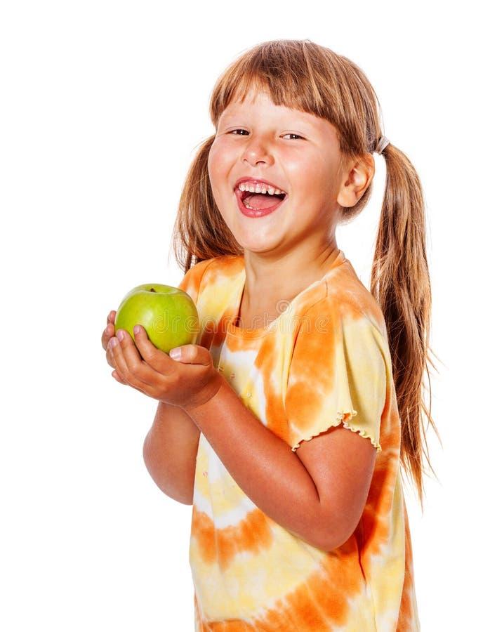 Pomme de fixation de fille image stock