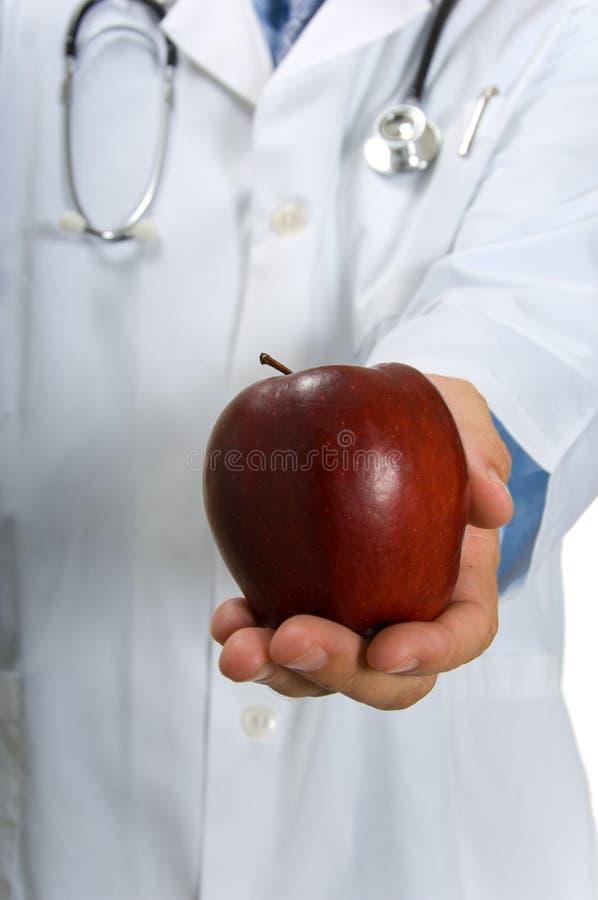 Pomme de offre de docteur images stock