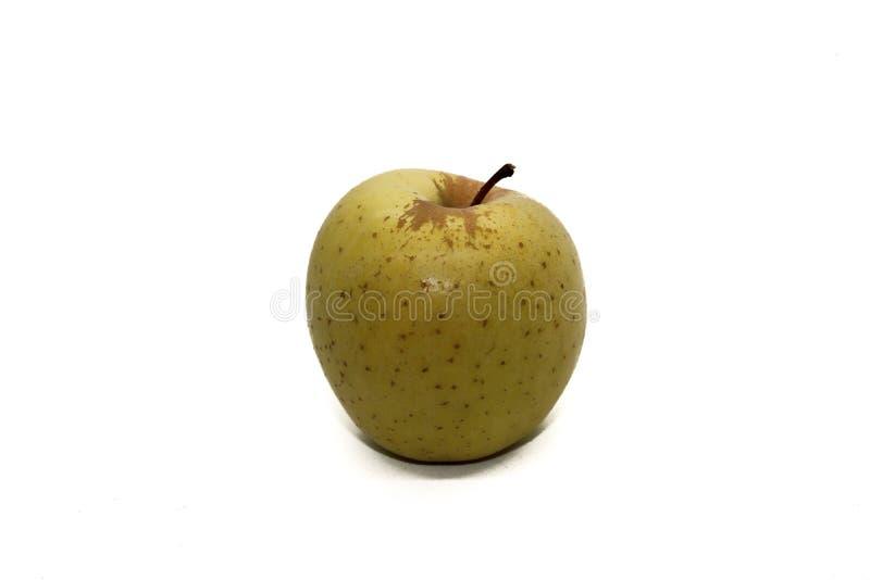 Pomme jaune avec les taches brunes image stock