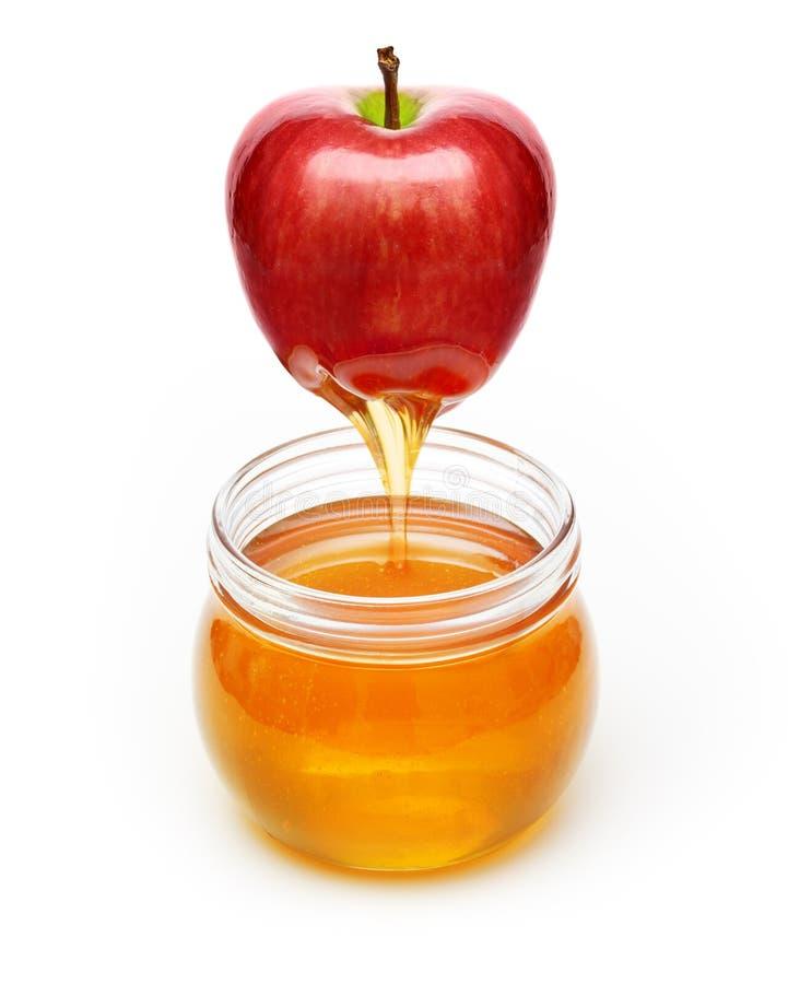Pomme rouge avec du miel photo stock