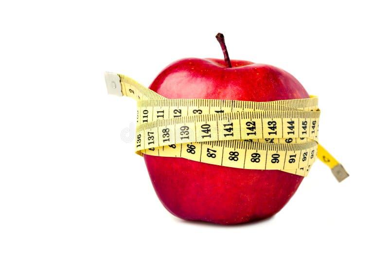 Pomme rouge avec la bande de mesure photographie stock