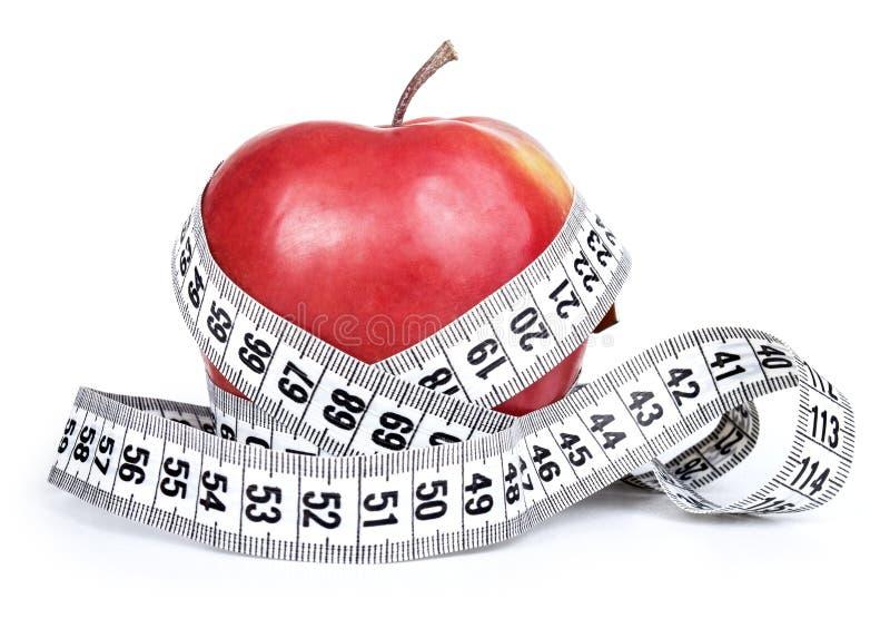 Pomme rouge avec la mesure images stock