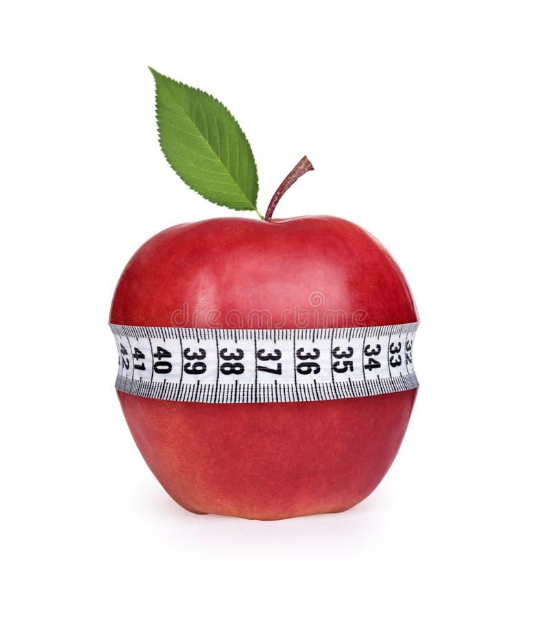 Pomme rouge avec la mesure photographie stock libre de droits