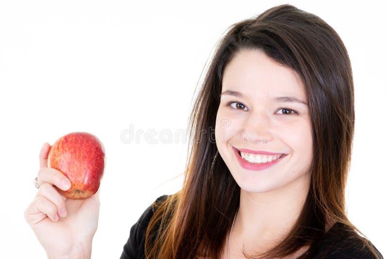 Pomme rouge de jeune jolie prise de femme sur le fond blanc photographie stock