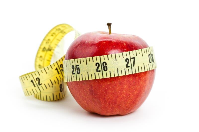 Pomme rouge et ruban métrique photo libre de droits