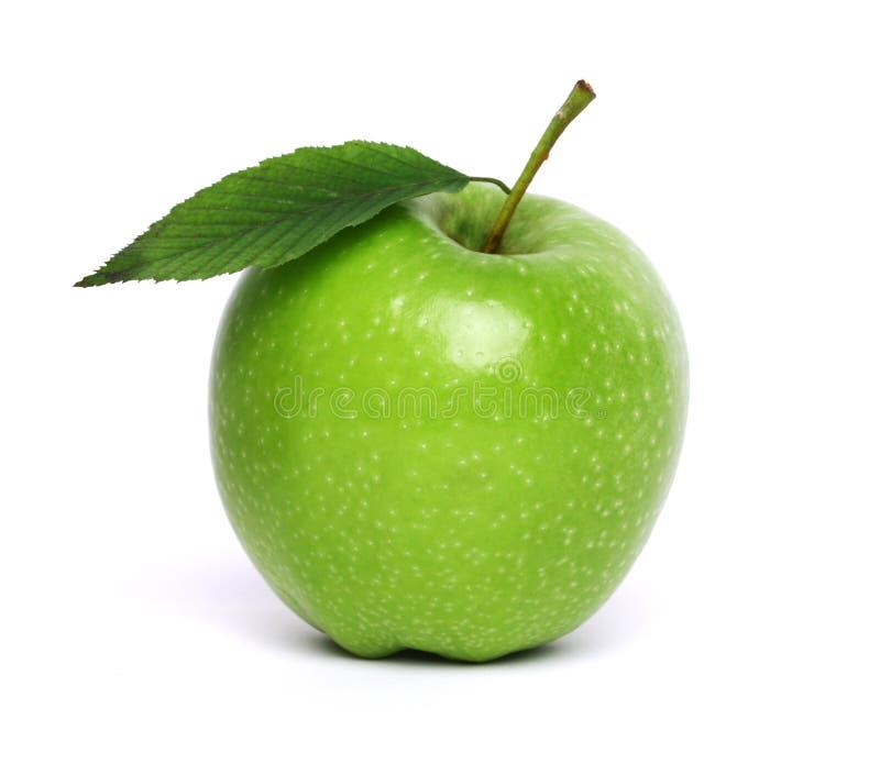 Pomme verte d'isolement sur le blanc images libres de droits