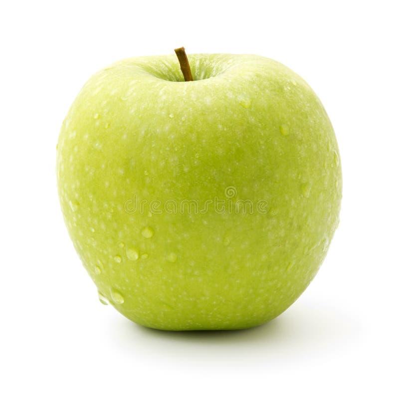 Pomme verte d'isolement sur le blanc images stock