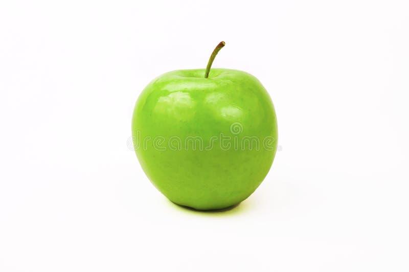 Pomme verte fraîche brillante sur fond blanc photographie stock
