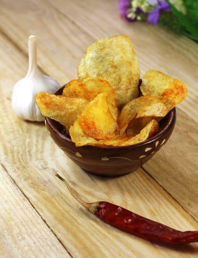 Pommes chips épicées photographie stock
