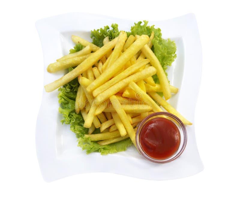 Pommes chips avec le ketchup et la laitue image stock