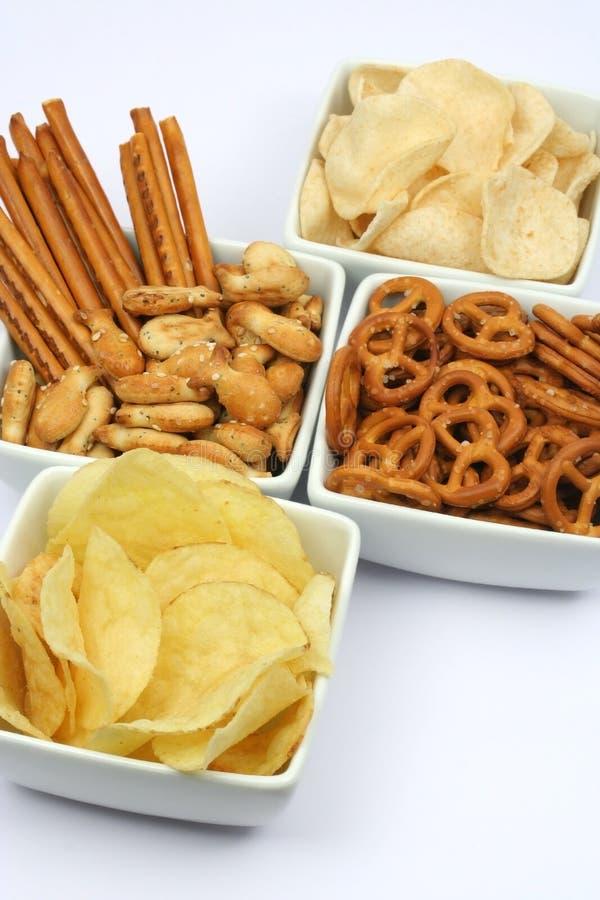 Pommes chips et casse-croûte photographie stock