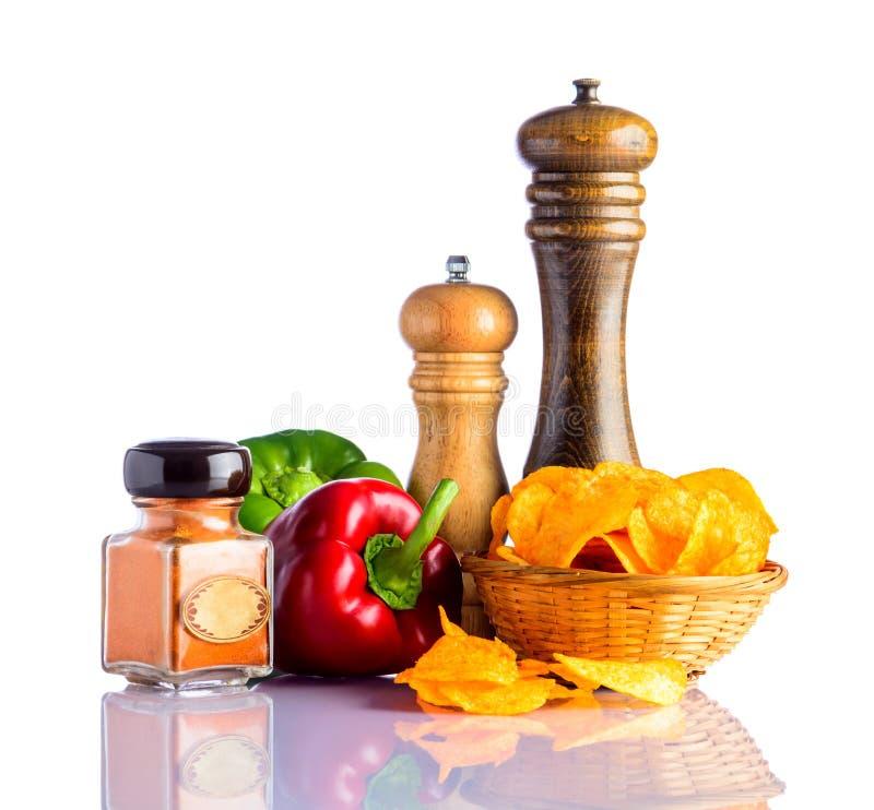 Pommes chips et poivre photos stock