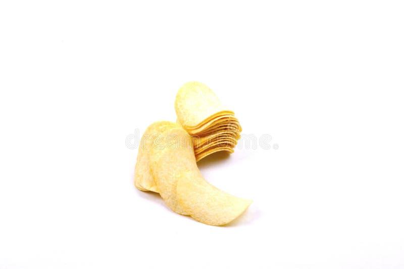 Pommes chips (frites) sur un fond blanc images libres de droits
