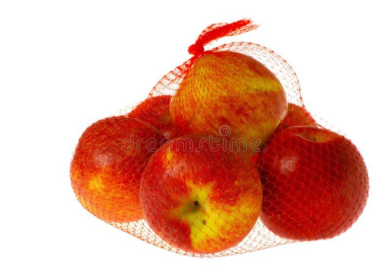 Pommes dans le sac net d'isolement photo libre de droits